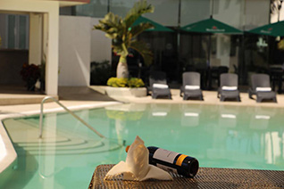 Enjoy a good wine in front of the pool