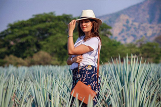 Tourist enjoying the view of the agave field