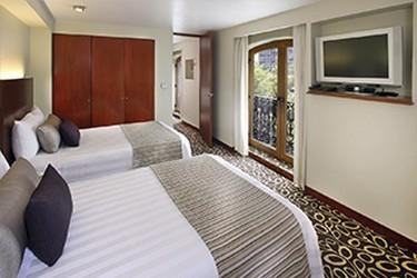 Habitación suite con 2 camas